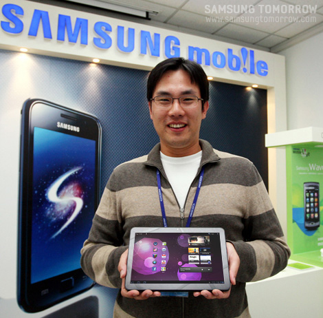 Assistant Manager Kim Dong-joon smile with galaxy tab 10.1 on his hands
