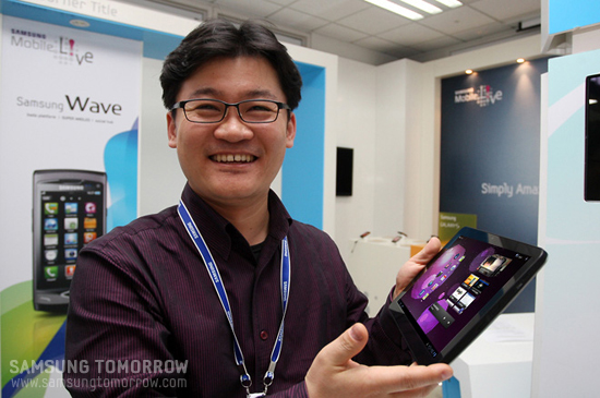 Senior Manager Kang Byung-jin smile with galaxy tab 10.1 on his hands
