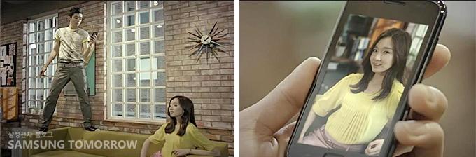스마트폰으로 여자의 사진을 찍는 남자