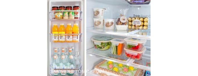초콜렛,치즈,과일,야채등으로 가득차 있는 냉장고 내부