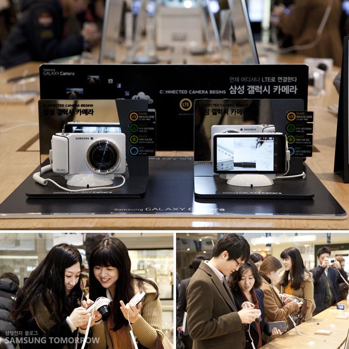 삼성갤럭시스마트카메라를 체험하는 사람들