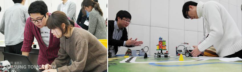로봇 페스티벌 현장에서 로봇 구동을 위한 알고리즘 구현과 문제해결 방법을 찾고 있는 교육생들