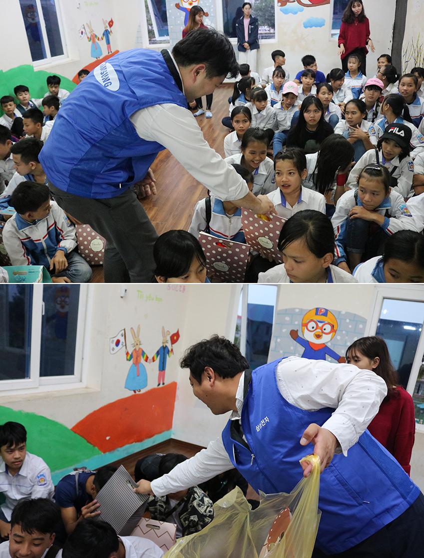 ▲ 직접 만든 가방과 학용품 키트를 아이들에게 나눠주고 있는 임직원들의 모습