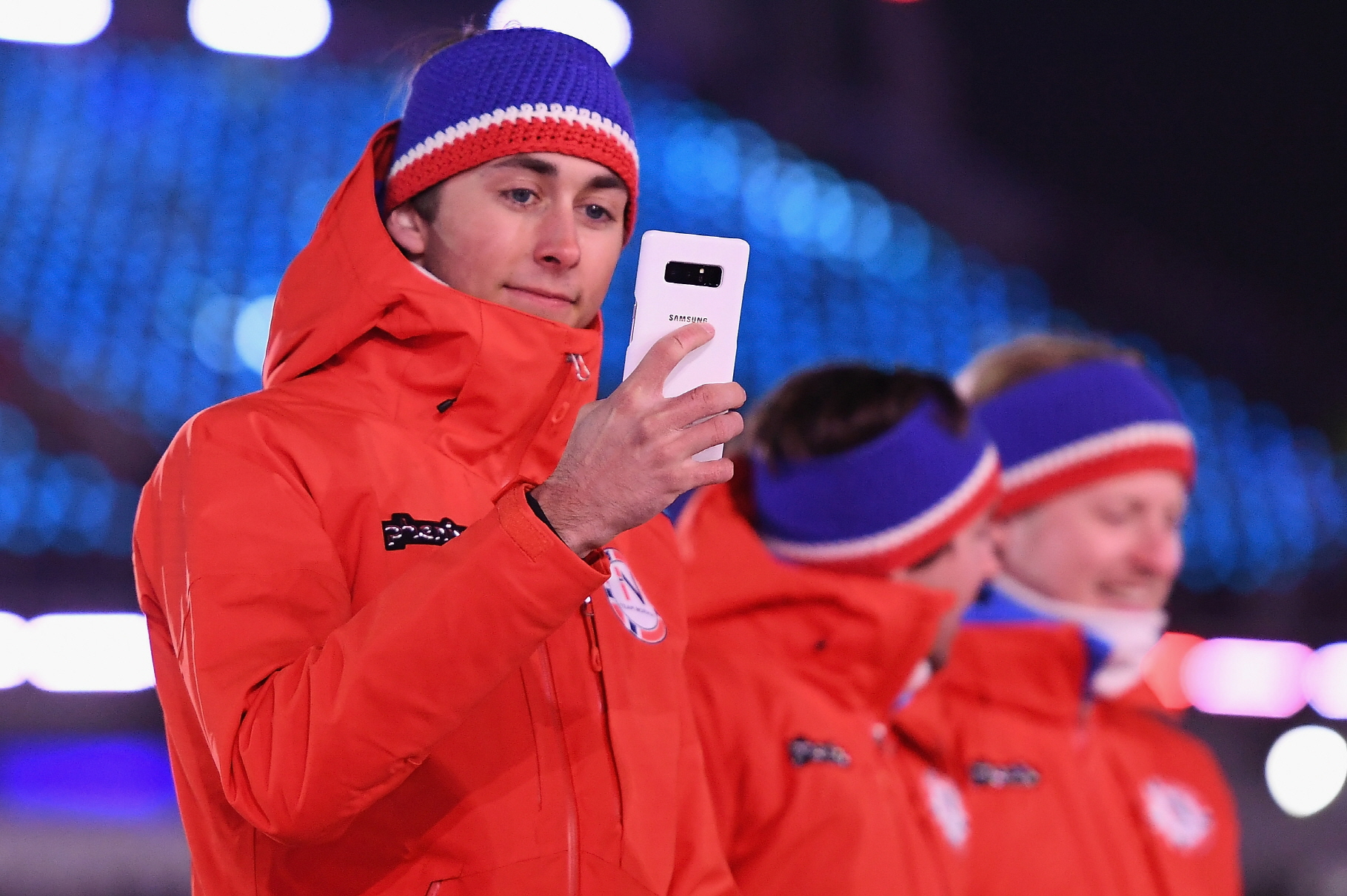 PYEONGCHANG-GUN, SOUTH KOREA - FEBRUARY 09:  A member of Team Netherlands takes a selfie with a Samsung phone during the Opening Ceremony of the PyeongChang 2018 Winter Olympic Games at PyeongChang Olympic Stadium on February 9, 2018 in Pyeongchang-gun, South Korea.  (Photo by Quinn Rooney/Getty Images)