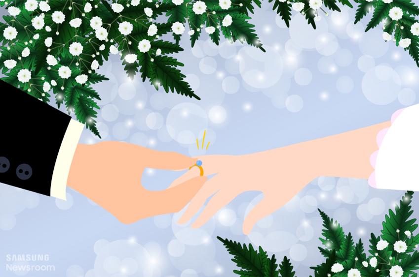 안개꽃을 배경으로 여자에게 반지를 끼워주는 남자의 모습