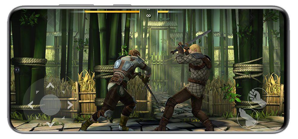 120Hz 고주사율 디스플레이위에 대전 격투 게임 화면이 띄워져 있는 모습