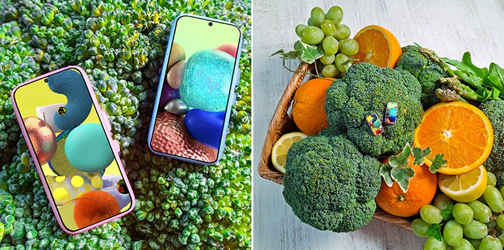 A. 여러 종류의 과일과 야채 사이의 브로콜리. 그 위에 놓인 미니어처 갤럭시 A51.